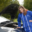 Stock Photo: Female car mechanic with in action