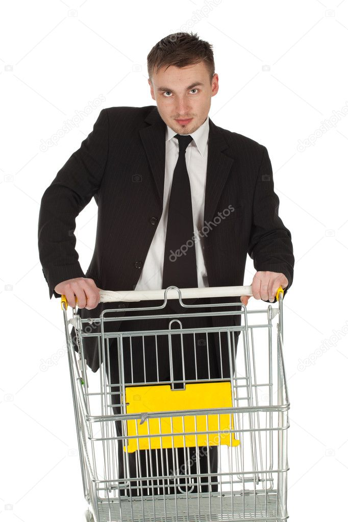 Businessman in black suit and shopping cart — Stock Photo #6768318
