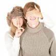 Secret girl covering boyfriend's eyes — Stock Photo