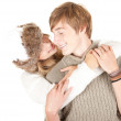 Woman kissing boyfriend — Stockfoto