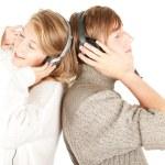 Happy couple in headphones — Stock Photo #6837269