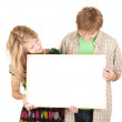 Couple holding blank billboard — Stock Photo