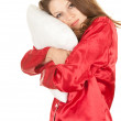 Girl in red pajamas with pillow — Stock Photo #6838429