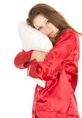 Girl in red pajamas with pillow — Stock Photo