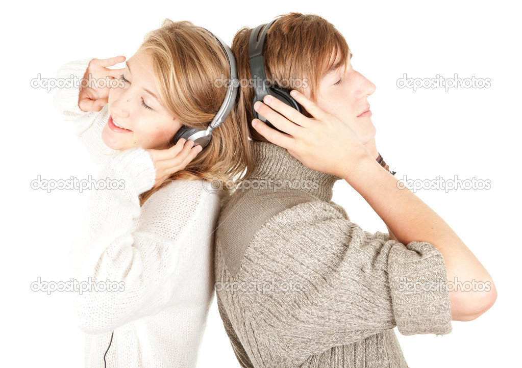 Happy young couple in headphones listening music with pleasure  Stock Photo #6837269