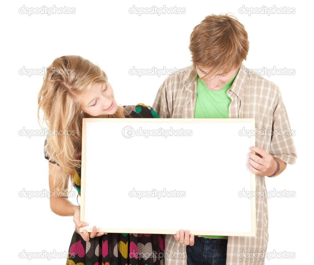 Young interested couple holding blank billboard, poster — Stock Photo #6837388