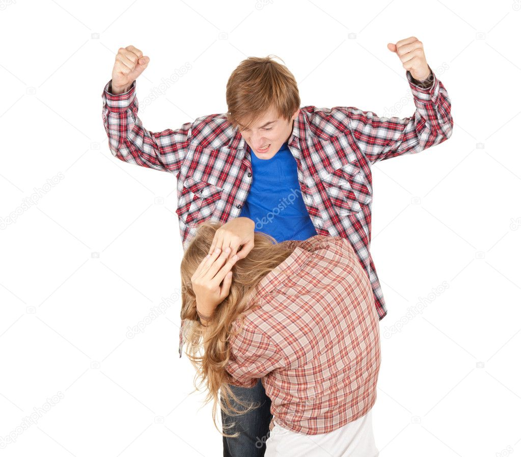 Young caucasian couple is arguing, fights, man striking woman — Stock Photo #6837492