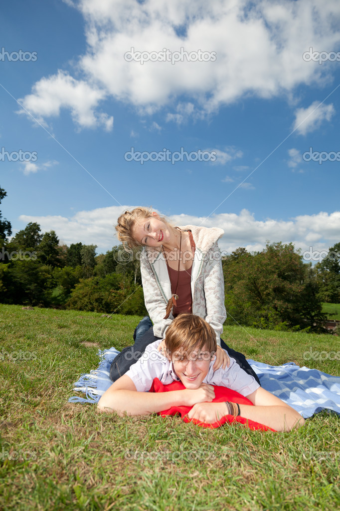 Happy young couple in sunny day on the meadow — Stock Photo #6837605
