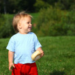 Baby boy on the meadow, series - Stock Photo