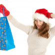 Christmas girl with shopping bag — Stock Photo