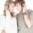 Young couple in headphones — Stock Photo