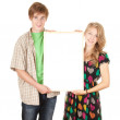 Couple holding blank poster — Stock Photo #6880361