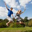 Stock Photo: Couple jump