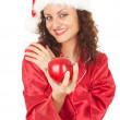 Santa girl with red apple — Stock Photo