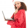 Santa girl with laptop — Stockfoto