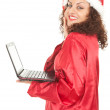 Santa girl with laptop — Stock Photo