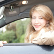 Young woman driving a car — Stock Photo