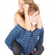 Boyfriend giving girl a piggyback — Stock Photo