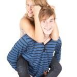 Boyfriend giving girl a piggyback — Stock Photo #6908399