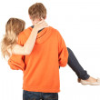 Boyfriend carrying girl in his arms — Stock Photo