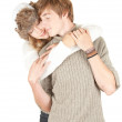 Young woman kissing boyfriend — Stok fotoğraf