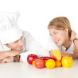 Cooks team with fruits and vegetables — Stock Photo #6908567