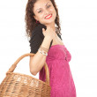 Shopping girl with wicker basket — Foto Stock