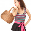 Shopping girl with wicker basket — Stockfoto