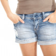 Body part of girl in jeans shorts — Stock Photo