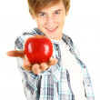 Young man offering an apple — Stock Photo