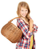 Shopping girl with wicker basket — Stock Photo
