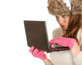 Scared winter woman with laptop — Stock Photo