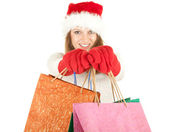 Christmas girl with shopping bags — Stock Photo