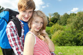 Young couple with backpack — Stock Photo