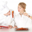 Chef examining cook, series — Stock Photo #6915296
