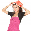 Young woman with book on head — Stock Photo