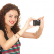 Backpacker girl with camera — Stock Photo