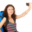 Backpacker girl with camera - Stock Photo