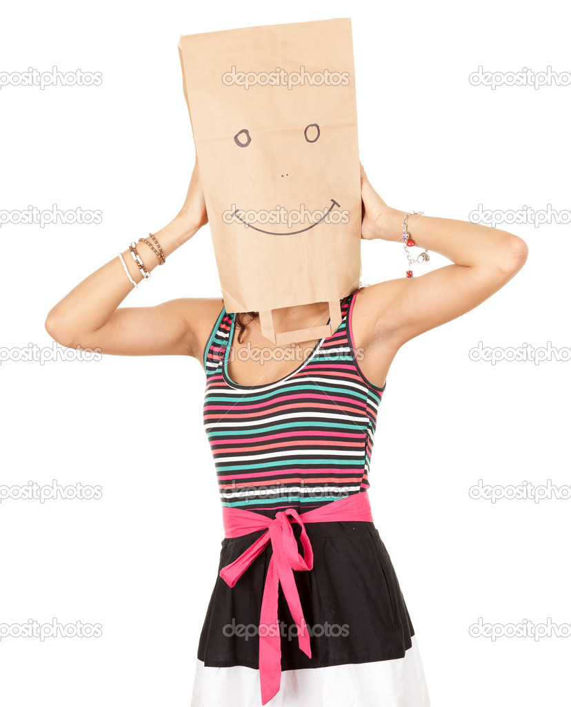 Young woman in smiling ecological paper bag on head, series — Stock Photo #6915476