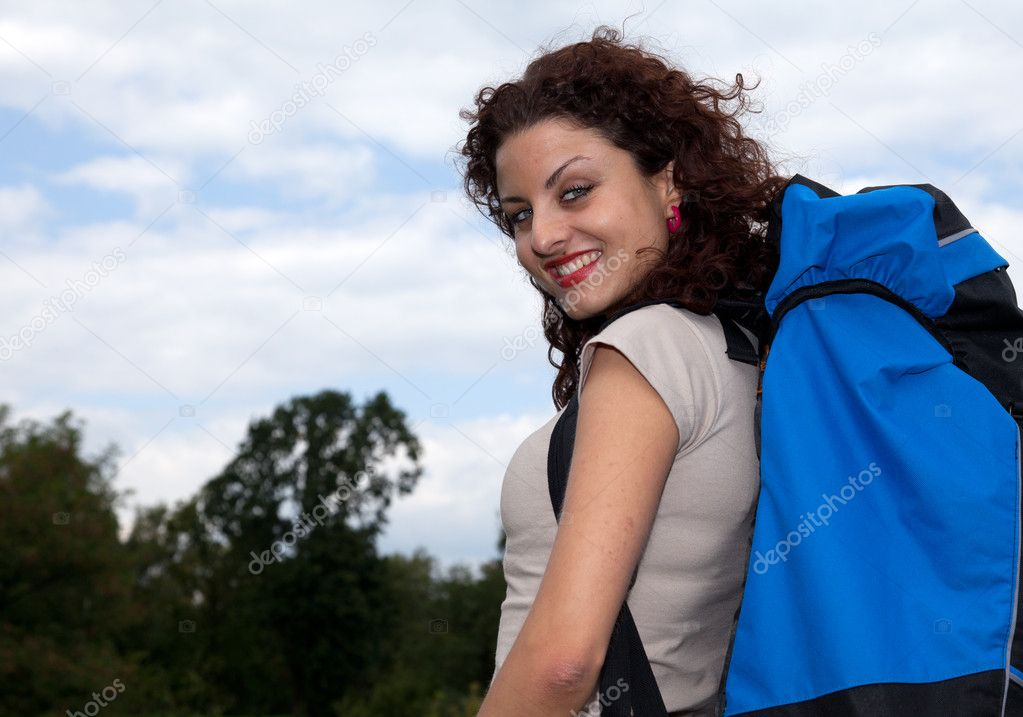Young woman hiker on blue sky background — Stock Photo #6915562