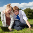 Teenage couple using laptop — Stock Photo #7045790