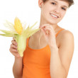 Happy girl with raw corn — Stock Photo