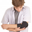 Man with elbow in medical bandage — Stock Photo