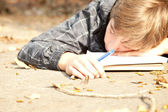 Male student learning in the park — Stock Photo
