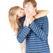 Girlfriend kissing surprised man — Foto Stock