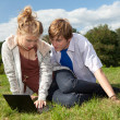 Teenage couple using laptop — Stock Photo #7094279