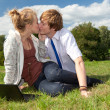 Teenage couple using laptop — Stock Photo #7094316