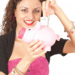 Girl putting five euro in piggy bank — Stock Photo