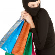 Thief with stolen shopping bags — Stock Photo