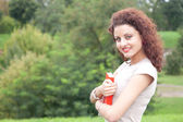 Female student in the park — Stock Photo